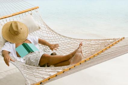 man relaxing in a hammock at the Caribbean beach