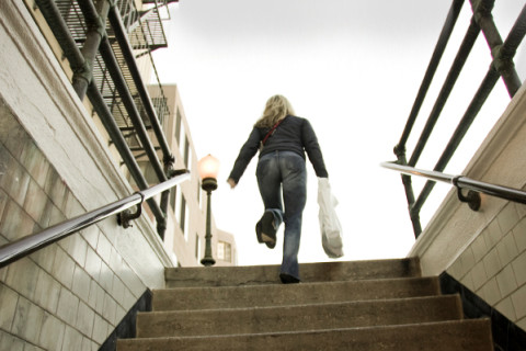 winter-woman-climbing-stairs