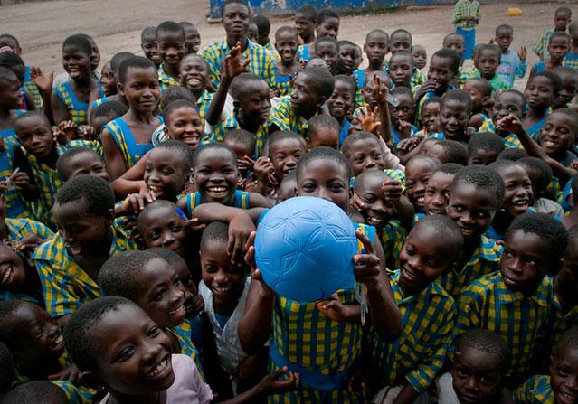 Children with the One World Futbol.